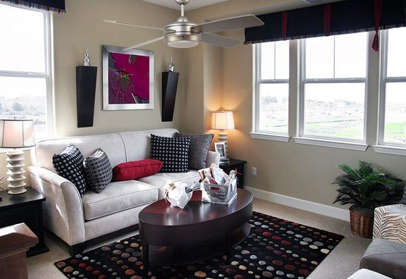 Four blade ceiling fan in Brushed Nickel in a contemporary staged living room.